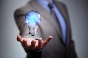 Businessman with illuminated light bulb concept for idea, innova